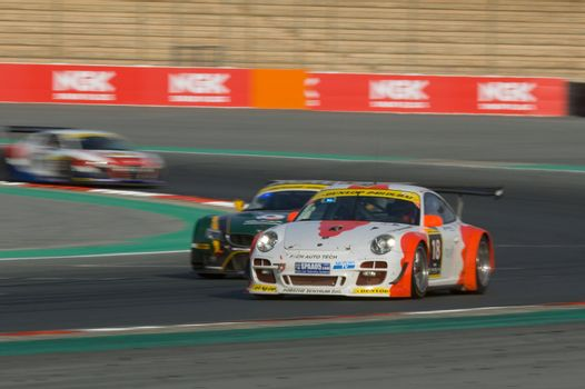 DUBAI - JANUARY 13: Car 18, a Porsch 997 GT3 R, participating in the 2012 Dunlop 24 Hour Race at Dubai Autodrome on January 13, 2012.