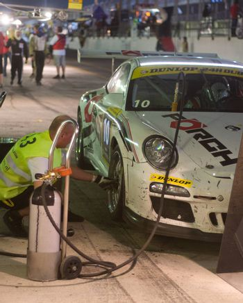 DUBAI - JANUARY 13: Pit stop at night for car 10, a Porsche 997 GT3 Cup during the 2012 Dunlop 24 Hour Race at Dubai Autodrome on January 13, 2012.