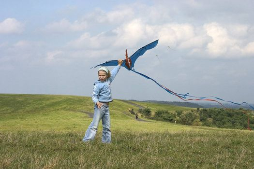 Child flying kite outdoor