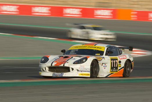 DUBAI - JANUARY 13: Car 117, a Ginetta G50, participating in the 2012 Dunlop 24 Hour Race at Dubai Autodrome on January 13, 2012.