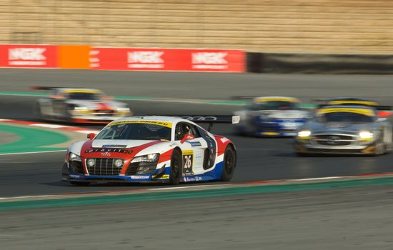 DUBAI - JANUARY 13: Car 26, an Audi R8 GT3 LMS, participating in the 2012 Dunlop 24 Hour Race at Dubai Autodrome on January 13, 2012.