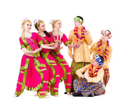 dance team dressed in Indian costumes posing.  Isolated on white background in full length.