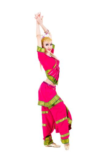 full length portrait of indian woman dancing in studio.  Isolated on white background.