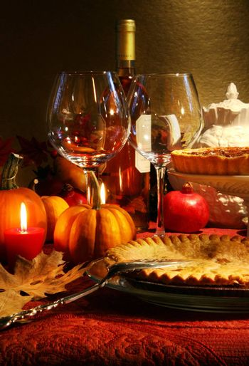 Table elegantly set with wine  for Thanksgiving