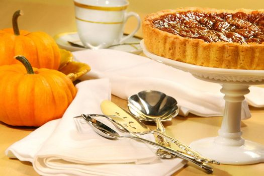 Pecan pie with small pumpkins on the table