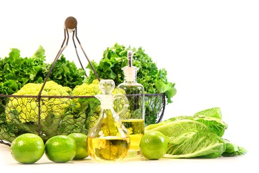 Garden fresh veggies with limes and salad oil