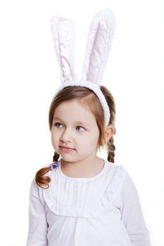 Portrait of baby girl with bunny ears headband