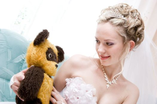 bride with a toy from her childhood