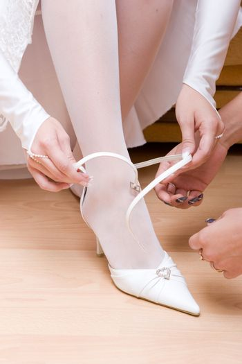 putting on a white shoe