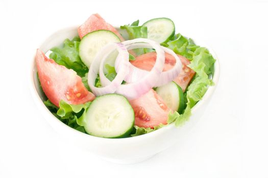 House salad in a white bowl and shot on a white background.