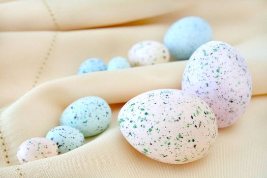 Colorful Easter eggs on a cloth background.