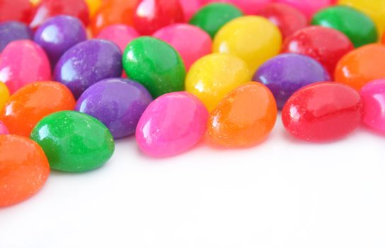Colorful jelly beans on a white background with copy space.