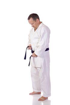 Karateka fastening his belt