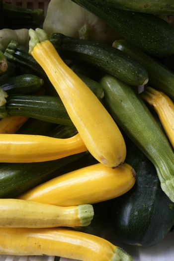 Green and yellow courgette in the marketplace