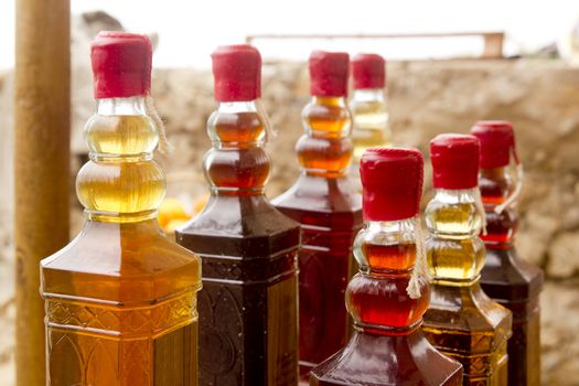 colorful traditional liquor bottles in rows