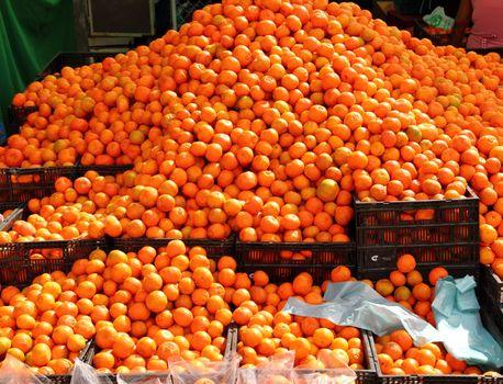 orange tangerines mound in market vivid citrus