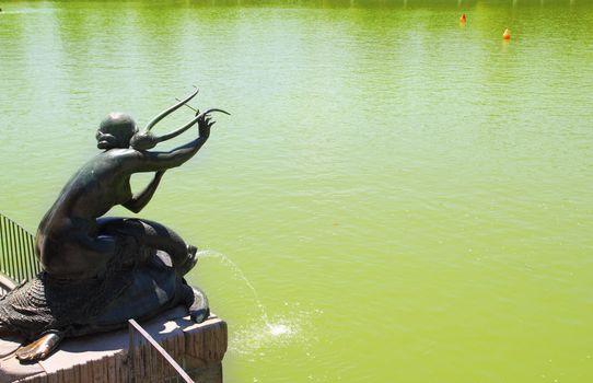 Madrid Sirena con Lira statue in Retiro lake