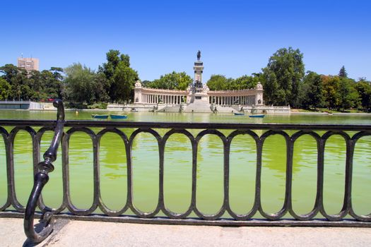 Retiro park lake in Madrid with fallen angel