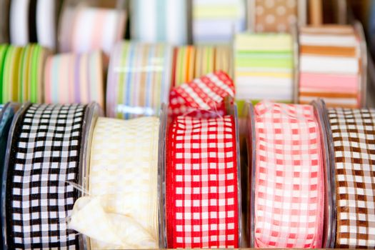 fabric tapes reels in haberdashery of vichy
