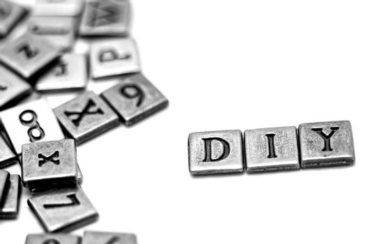 Metal scrapbooking letters spelling DIY