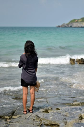 Lonely young woman on the beach