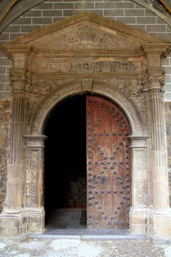 Anso Romanesque door arch in church Pyrenees