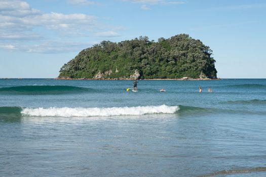 Tauranga, New Zealand, January 23, 2012, Paddleboarders enjoy scenic beach at Mount Maunganui.