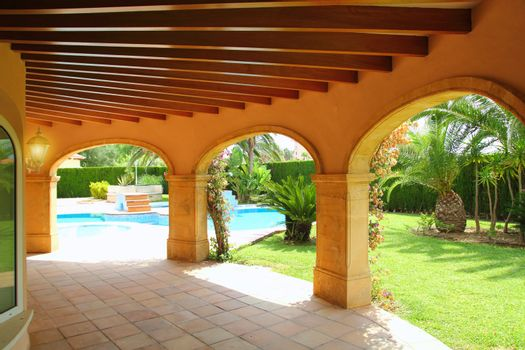 colonnade archs house swimming pool garden