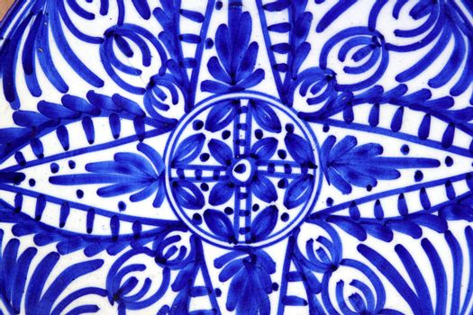 ceramics painted blue shapes plate
