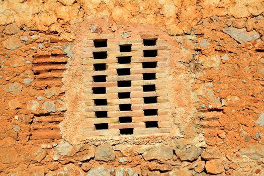 bricks window in masonry wall ancient architecture