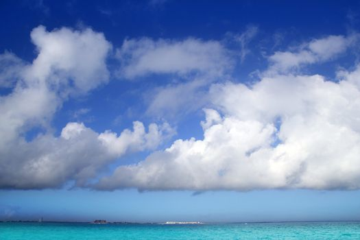 Cumulus clouds over caribbean turquoise sea
