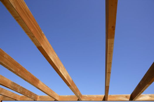 blue sky wooden golden awning beams