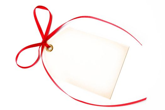blank gift tag tied with a red bow and shot on a white background.
