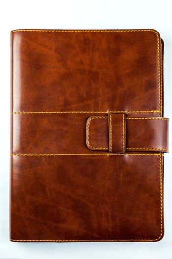 brown notebook on white background