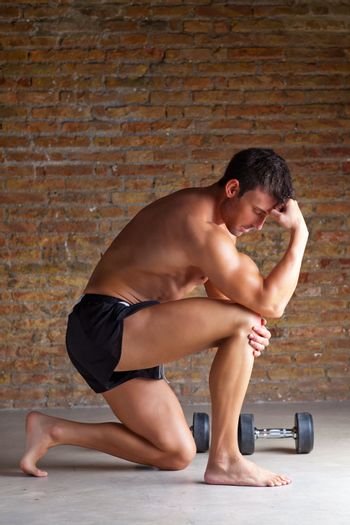 muscle  man thinking with thinker posture