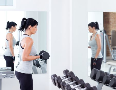 woman with weight training equipment on sport gym