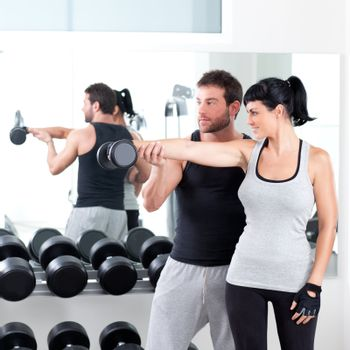 gym woman personal trainer with weight training