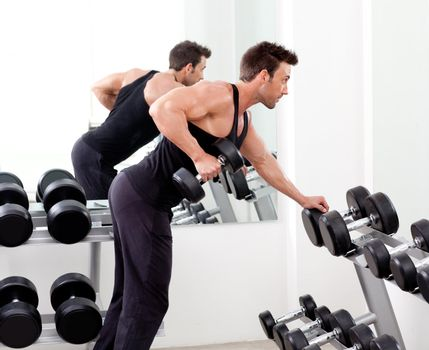 man with weight training equipment on sport gym
