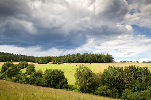 cloudscape over meadows in Burgsinn