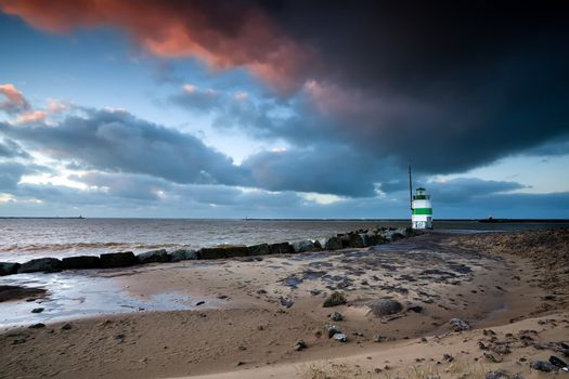 lighthouse by North sea at sunset