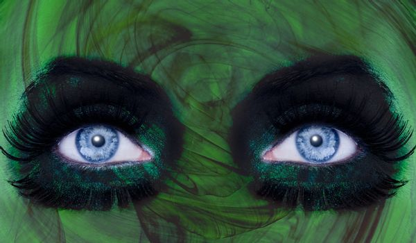 abstract blue woman eyes makeup with a green texture skin