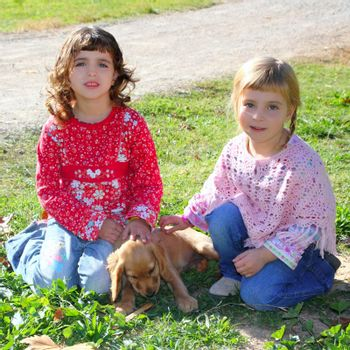 two little girls sister friends golden retriever puppy dog outdoor park