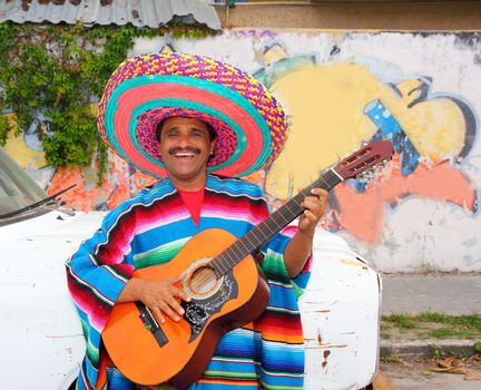 Mexican humor man smiling playing guitar sombrero