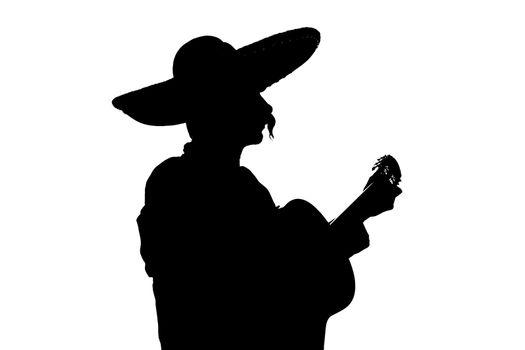 Charro Mariachi playing guitar backlight silhouette