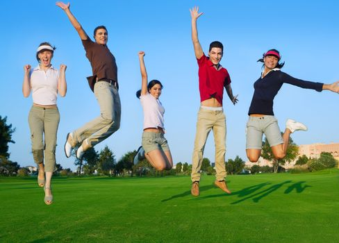 happy jump group of young people jumping outdoors grass