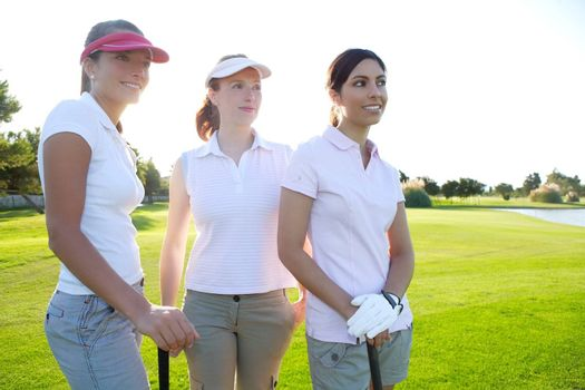 Golf three woman in a row green grass course players