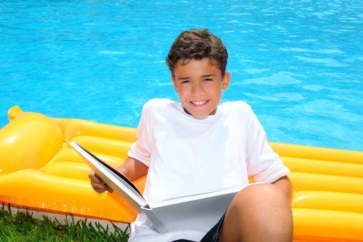 boy student teen vacation homework pool float