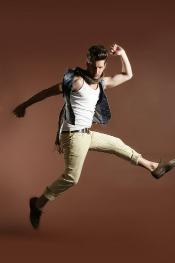 High jump fly young handsome fashion man
