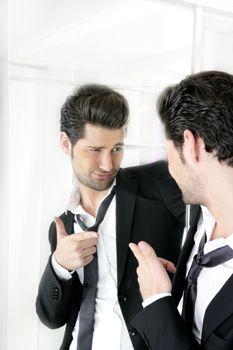 Handsome man humor funny gesture in a mirror