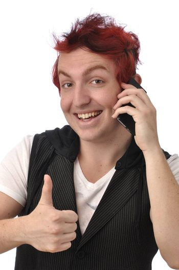 Young man gives a thumbs up as he talks on his smart phone communications device on white background